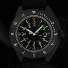 Pilots Navigator Quartz in black.  Tritium tubes provide self-glowing markers on the numbers, hands and at the #12 position on the bezel